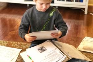Josiah fixing his papers