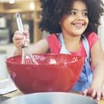 child helps baking