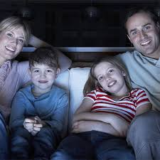 family watching together a movie
