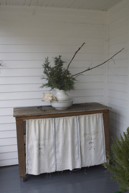 dresser with white overlay with pitcher with branches