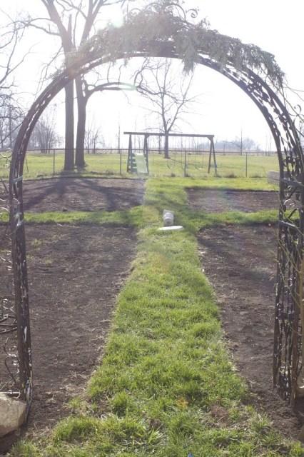 archway through to a potager garden