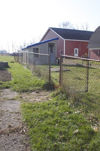 fence leading to barn area