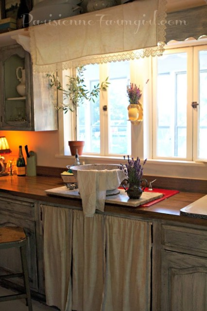 French Country Kitchen view of windows and fabric covering sink