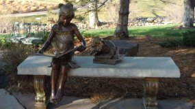 Parker Library Park girl reading book statue