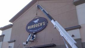 murdochs store sign going up in parker co