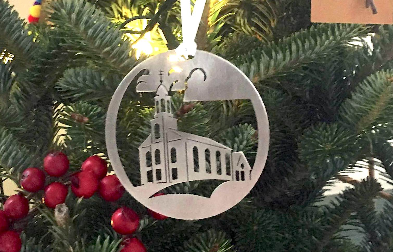 Christmas ornaments are decorations usually made of glass metal