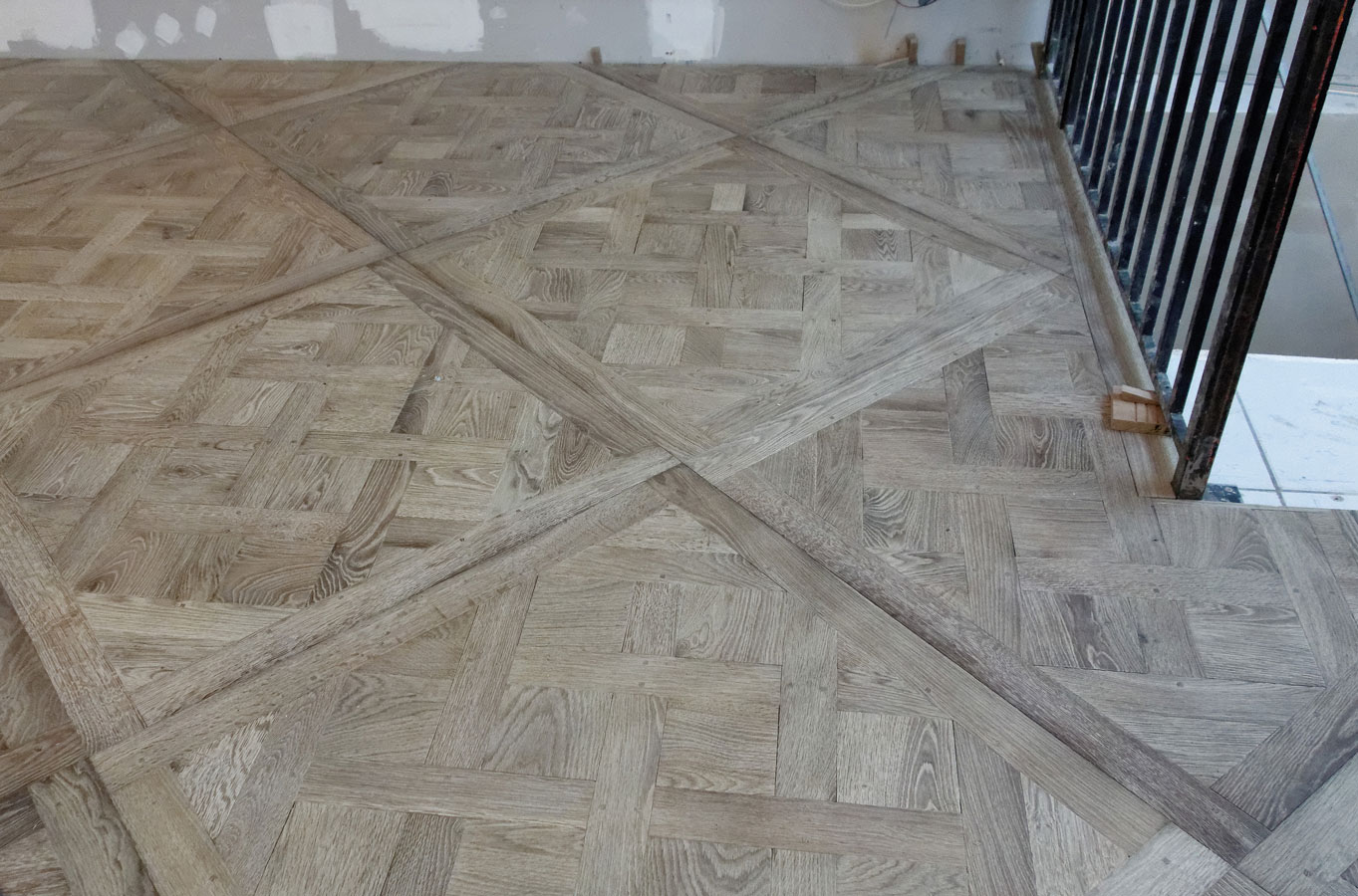 Implementation of Versailles panels parquet floor
