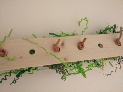 reverse side of vertical natural bird toys