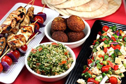 A Tradtional, Homemade Mezze with homemade pita, falafel, hummus, Muhammara, tabbouleh, kebabs, etc!
