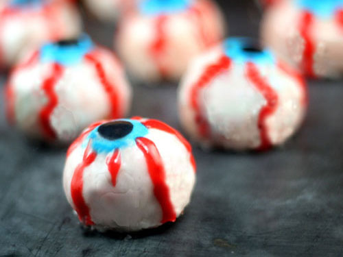 Bloody Doughnut Eyeballs. These Doughnut Hole Eyeballs bleed bloody red jam or jelly when you stick a fork on them! The perfect Halloween treat!