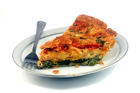 Magic Cheesy Vegetable Quiche/Pie. The pie magically forms three layers and its own top crust while baking. Creamy, gooey and delicious!