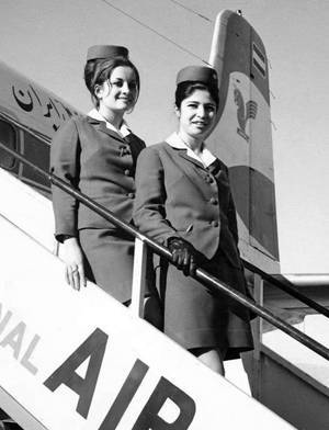 Iran Air flight attendants posing by a DC6 Plane - 1960s