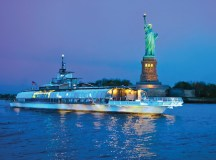 The Bateaux New York passes the Statue of Liberty.