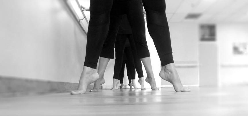 Passion Barre ladies on eleve floor view. Black and white