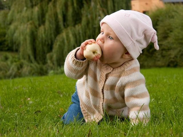 Baby girl in meadow