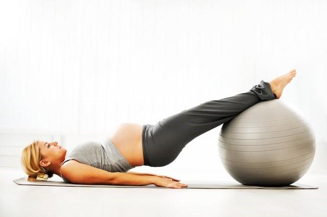Flexible pregnant woman.