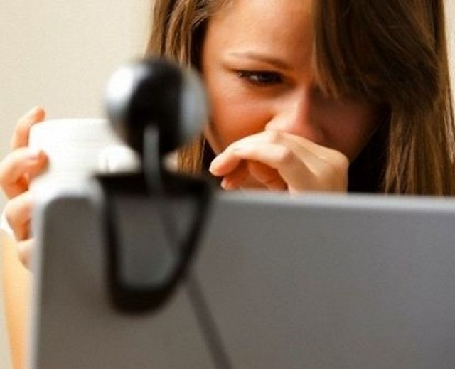 Close up of a woman using laptop computer with web cam
