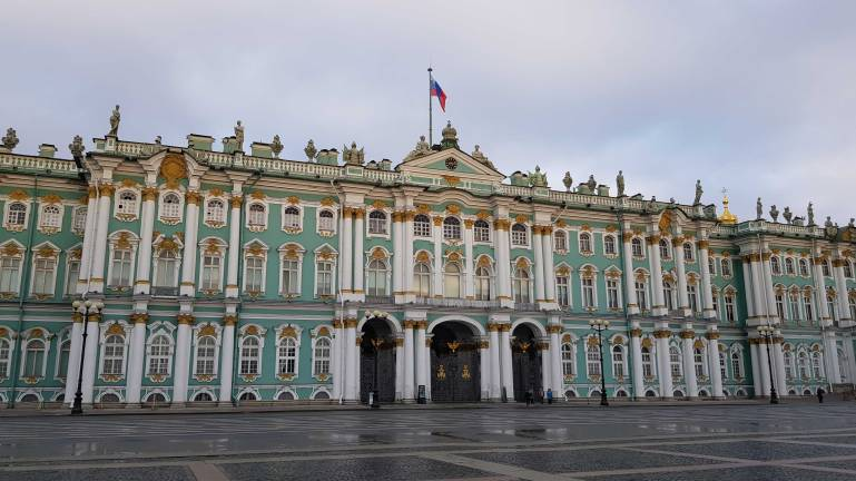 The beautiful, green and gold Winter Palace from Palace Square