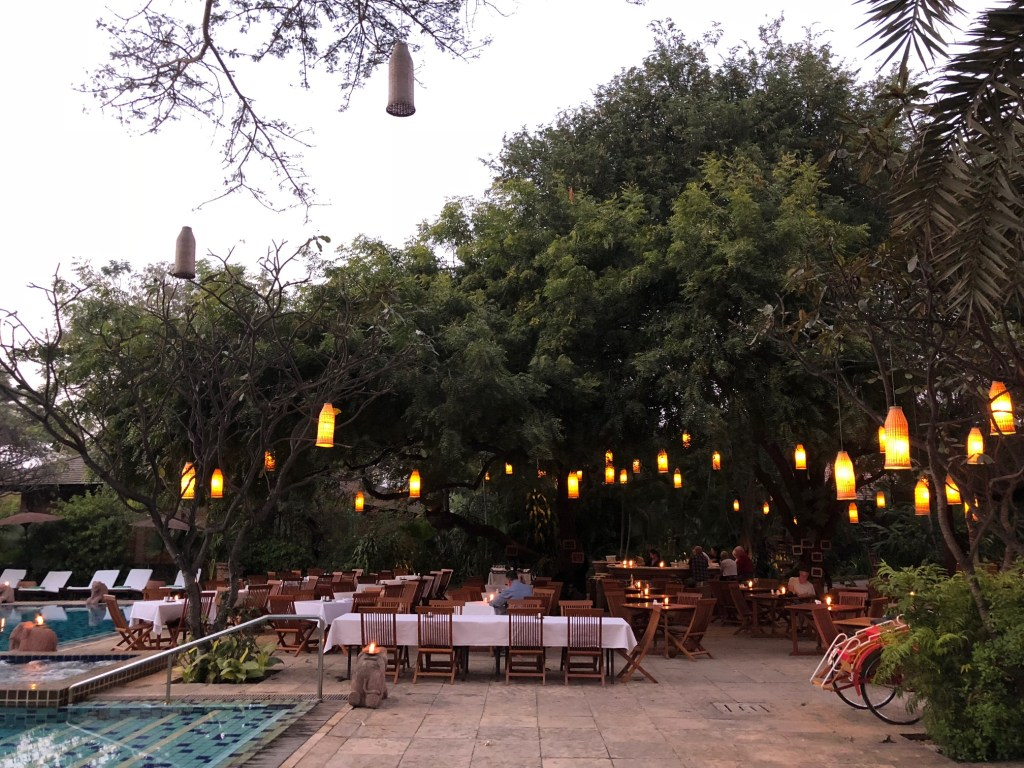The outdoor dining area and pool at Tharabar Gate
