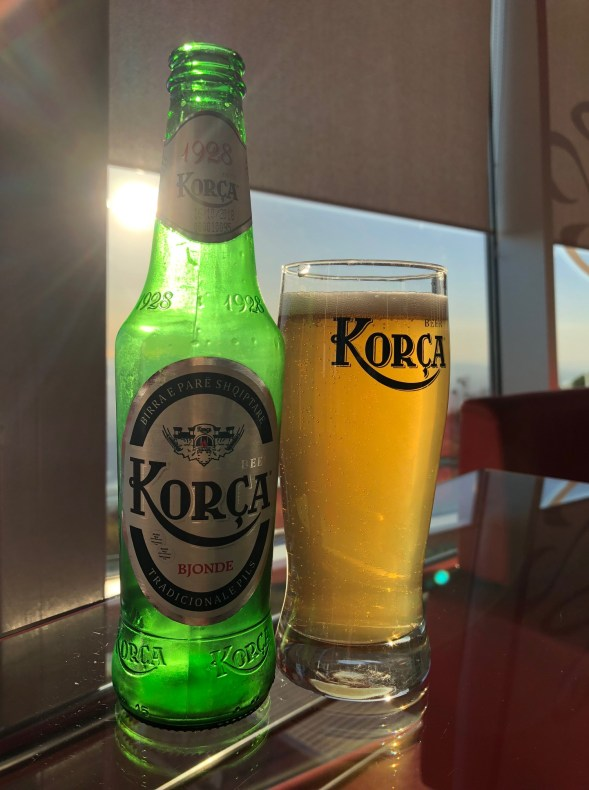 Enjoying a Korca beer at the top of the cable car in Tirana