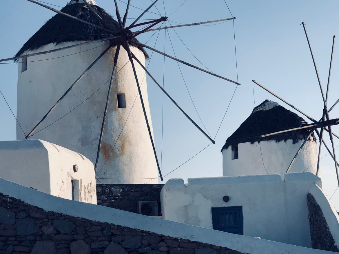See the famous windmills of Mykonos while Cyclades island hopping.