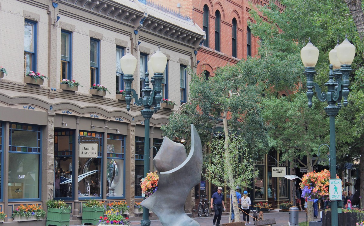 Shops in downtown Aspen (Daniel's Antiques). You can see old lamposts and lots of flower boxes.