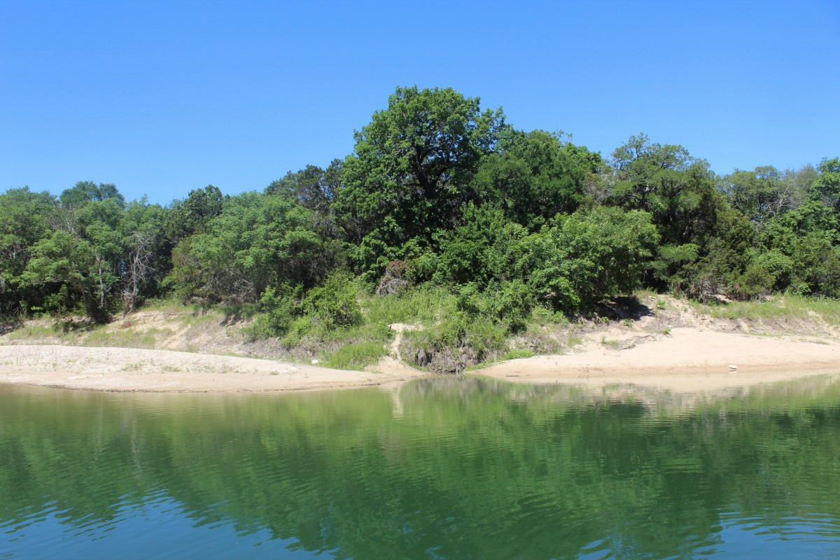 You have to cross the Palauxy River during your Dinosaur Valley State Park hiking trip