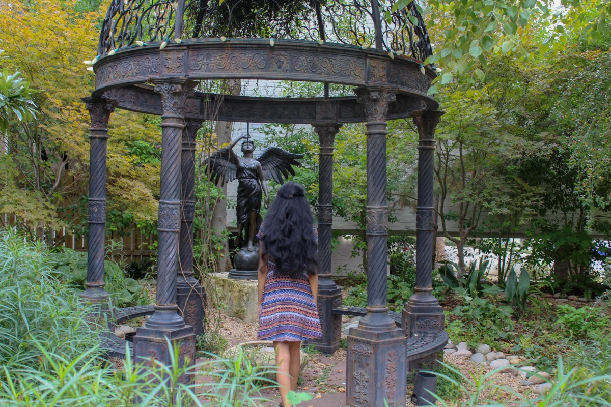 Girl with hair styled like Daenerys Targaryen entering into Dragon Park in Dallas, the cast iron gazebo and angel statue has a serious Game of Thrones Vibe