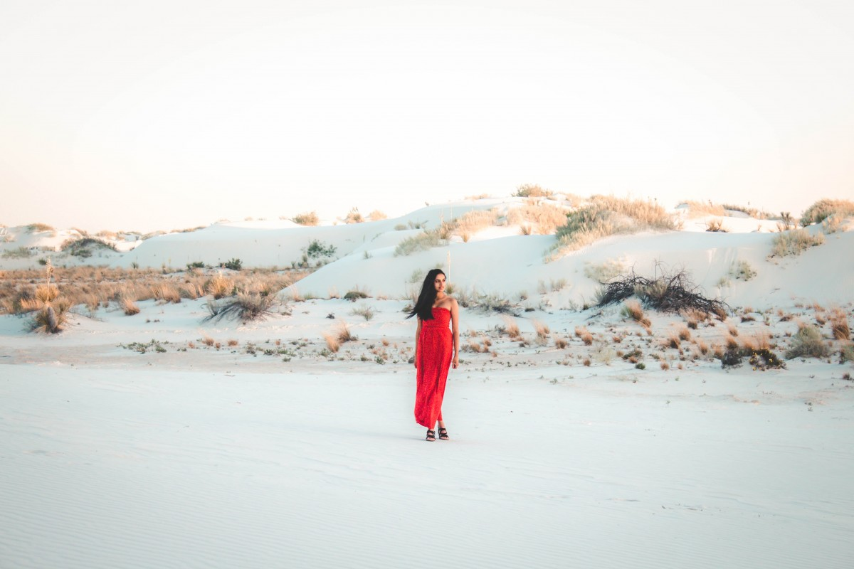 girl in red dress visiting White Sands National Monument