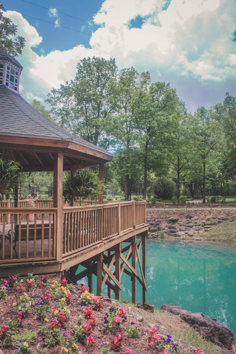 A gazebo overlooking the Blue Spring lagoon. The water is a sharp turquoise color.