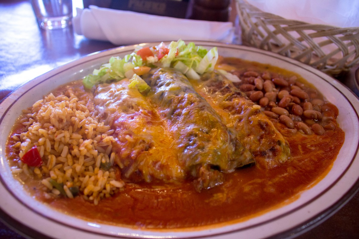 This was a sampler plate that I got in New Mexico. It's got one set of stacked enchiladas, lots of sauce, salad, beans, rice, and there's something in the middle that (like the good blogger I am), I completely forget what it is.