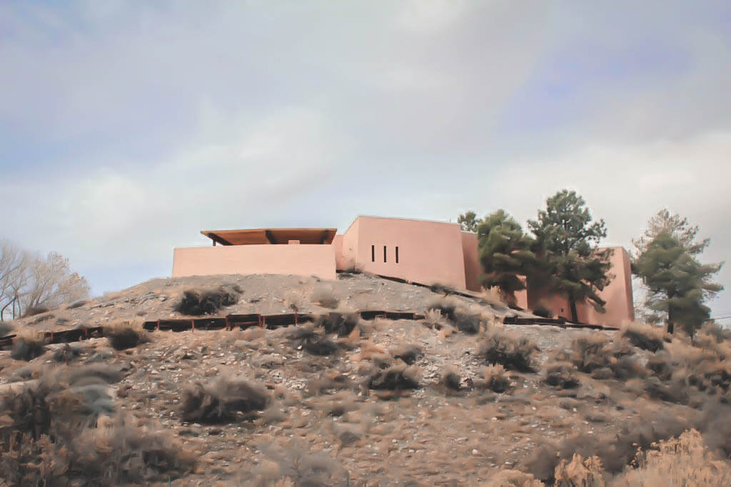 salmon colored building (the museum) on a mound