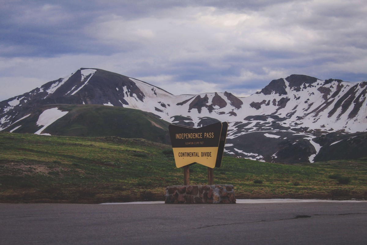 a photo of the Continental Divide location marker and sign along Independence Pass