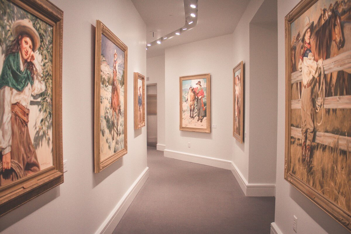 hall of Western cowgirl paintings by Terri Kelly Moyers'