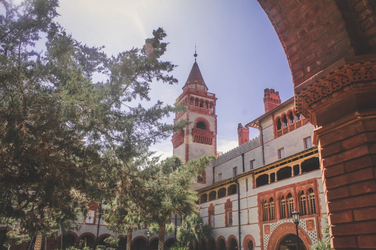 A view of Flagler College from underneath the ornate arches