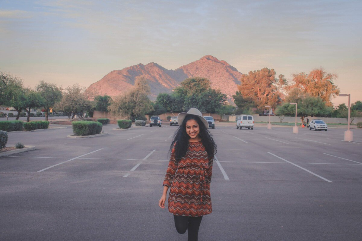 I'm standing in front of Camelback Mountain at sunrise in an empty parking lot.
