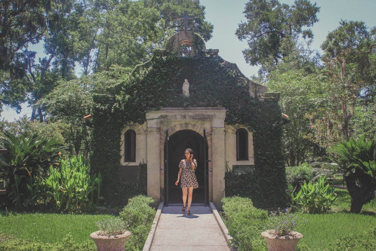 Our Shrine Of La Lady De Leche In St. Augustine, a chapel covered in ivy to the point where it's green.
