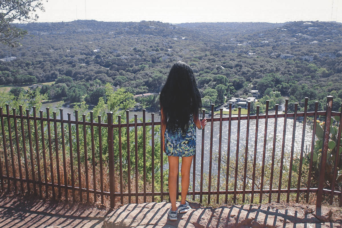 girl looking over Mount Bonnell during her one day in Austin