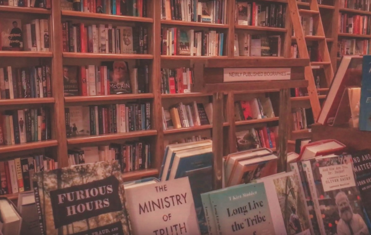 Deep oak shelves of Full Circle Bookstore in Oklahoma City