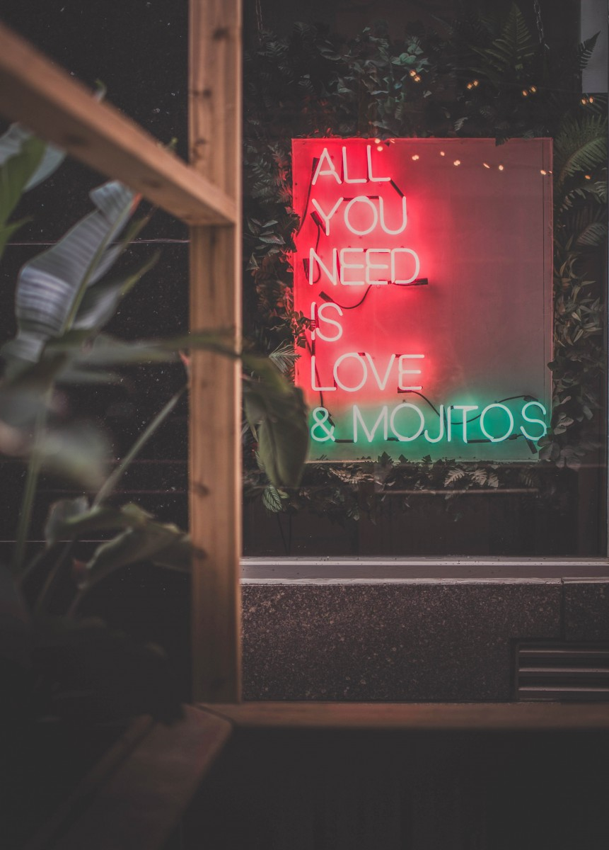 Montreal all you need is love & mojitos sign (this is why Montreal is one of the best party cities in Canada)