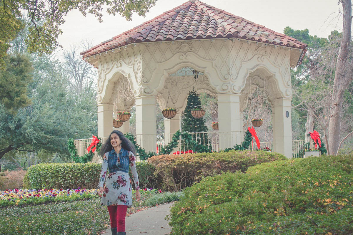 Anshula walking away from Dallas Flippen Park gazebo in winter (bows surrounding the gazebo)
