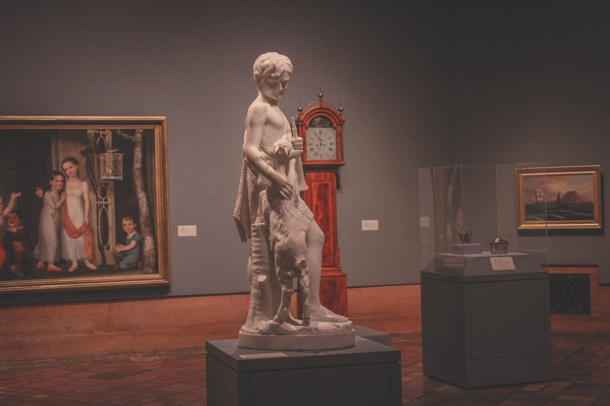 statue of a boy and a goat at the Joslyn Art Museum