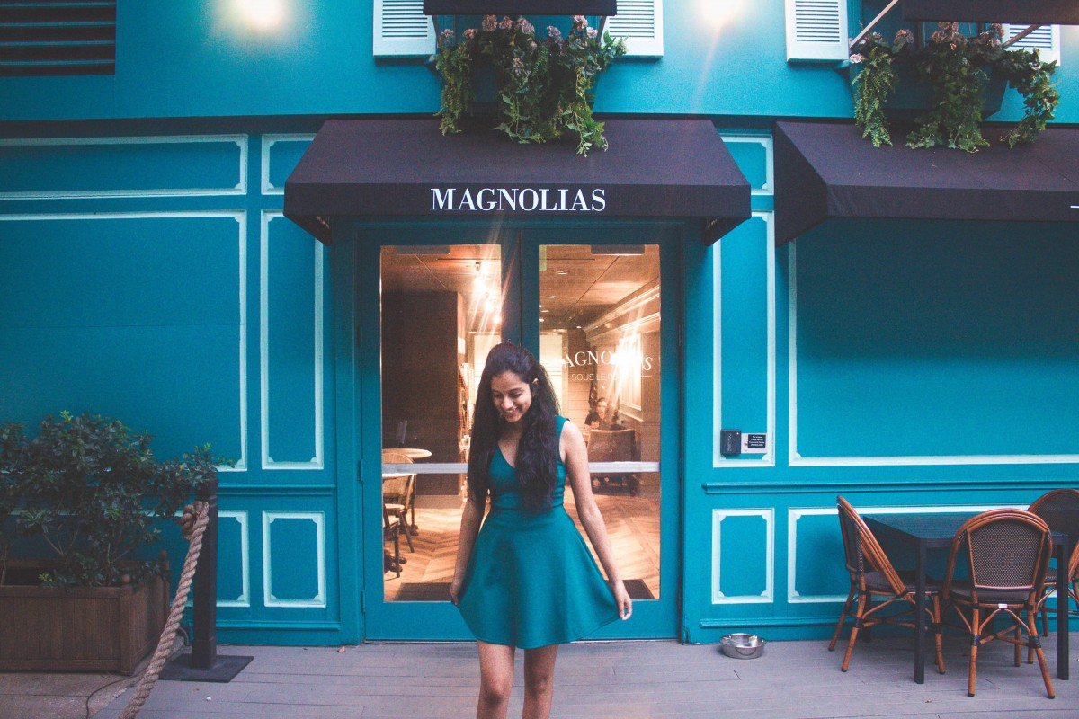 teal exterior of Magnolias Sous Le Pont coffee shop in Dallas