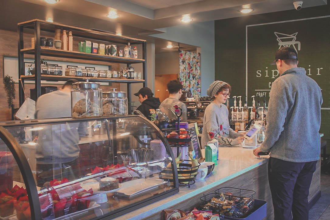 ordering a butterbeer latte from Sip Stir Coffee in Dallas