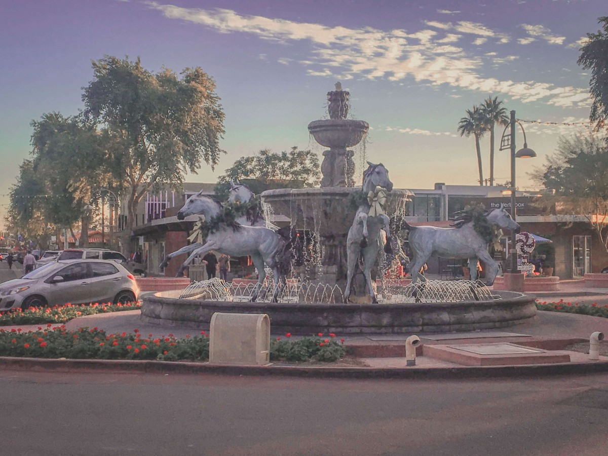 Iconic Bronze Horses Fountain Sculpture in Old Town