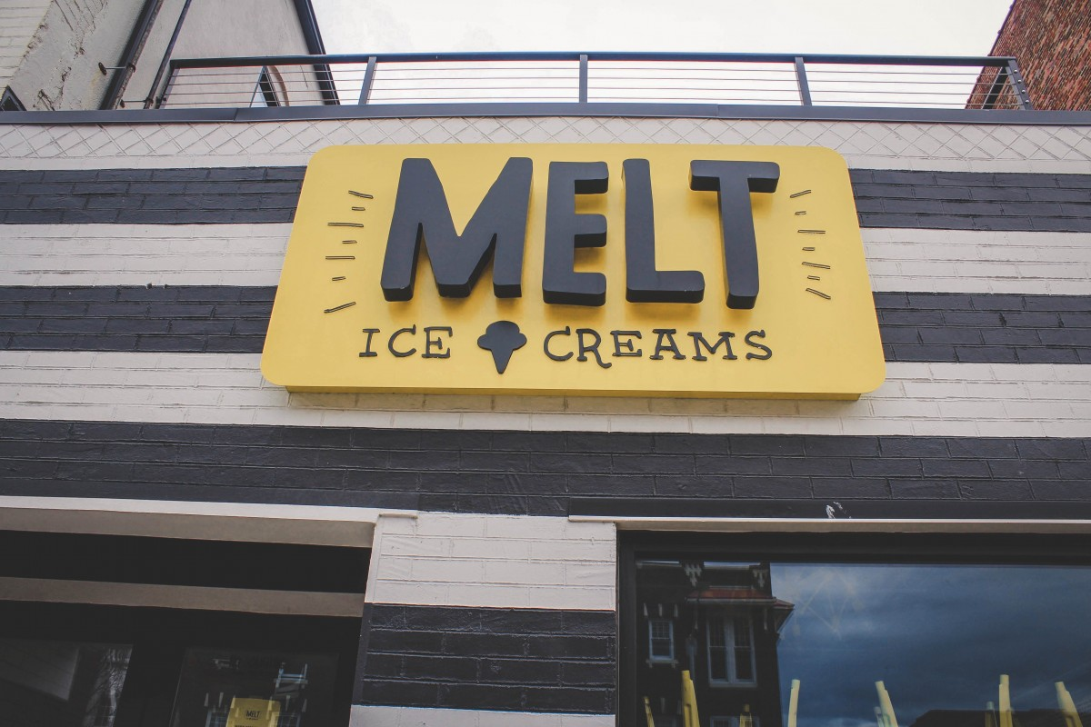 Facade of Melt Ice creams, yellow sign and striped black and white walls