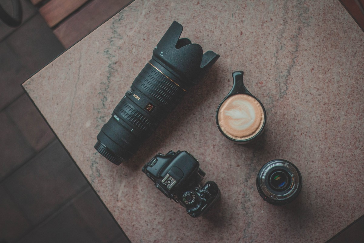 Coffee Shops In Waco - flatlay of camera gear and coffee