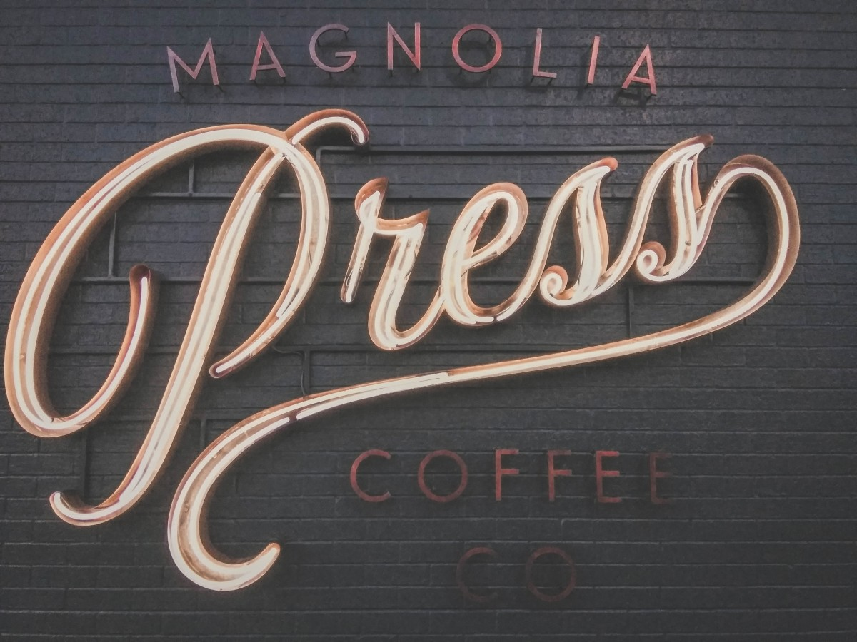 Coffee Shops In Waco - sign outside of Mangolia Press Coffee