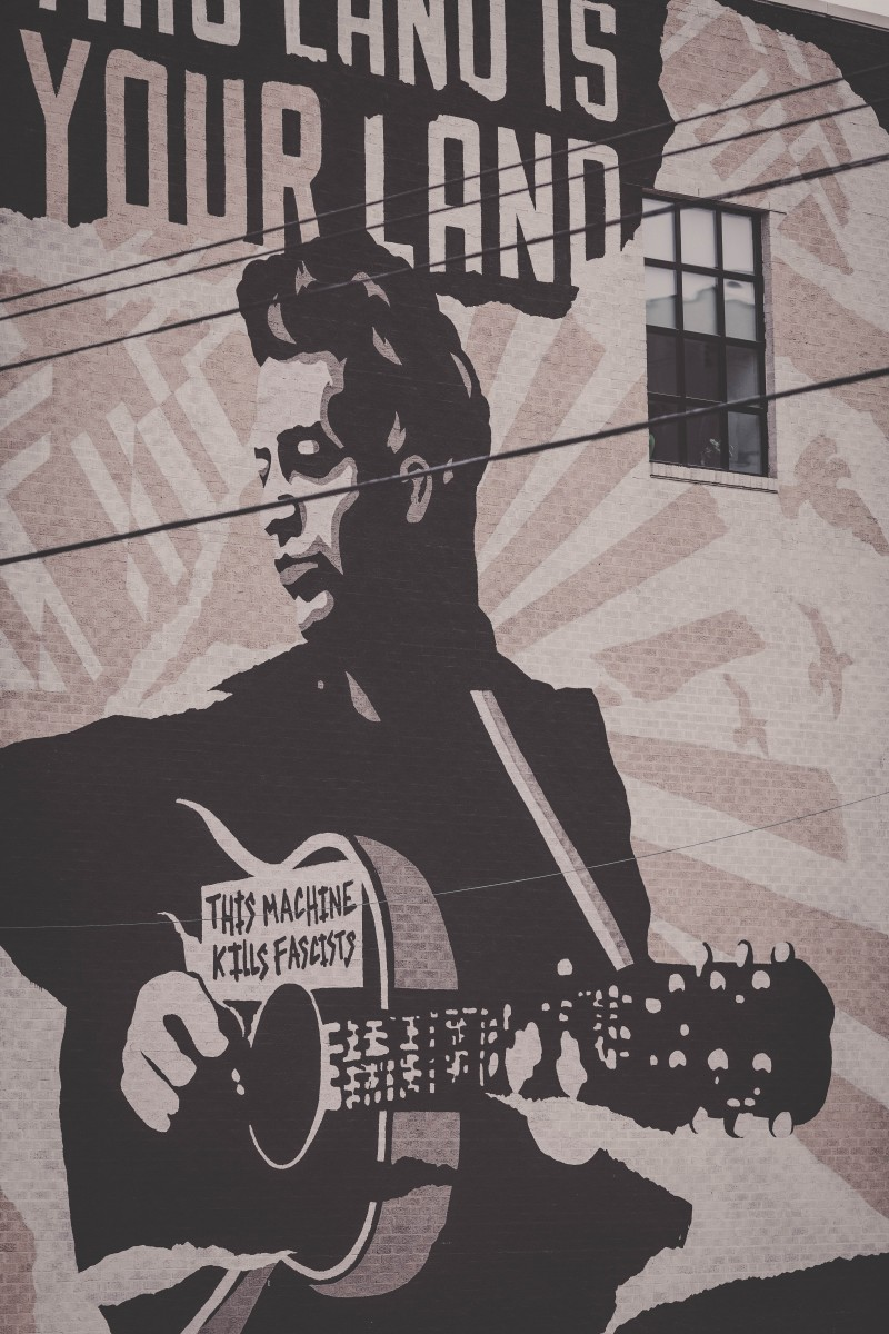 street art on the side of the Woodie Guthrie Center, one of the top things to do in Tulsa