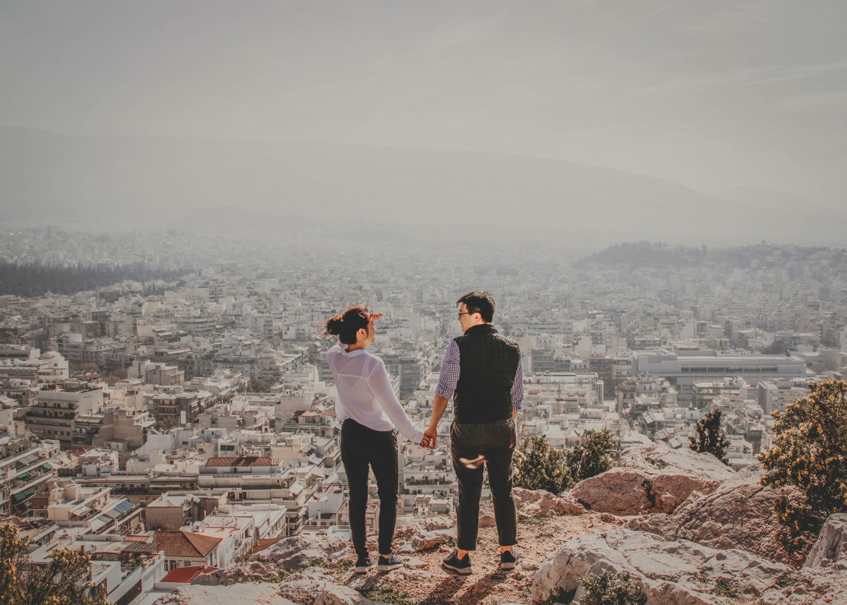 asian couple holding hands - road trip questions for couples